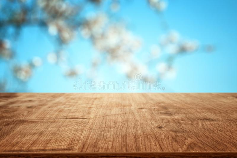 Wooden table in front of spring blossom tree landscape. Product display and presentation. Wooden table in front of spring blossom tree landscape. Product royalty free stock photography