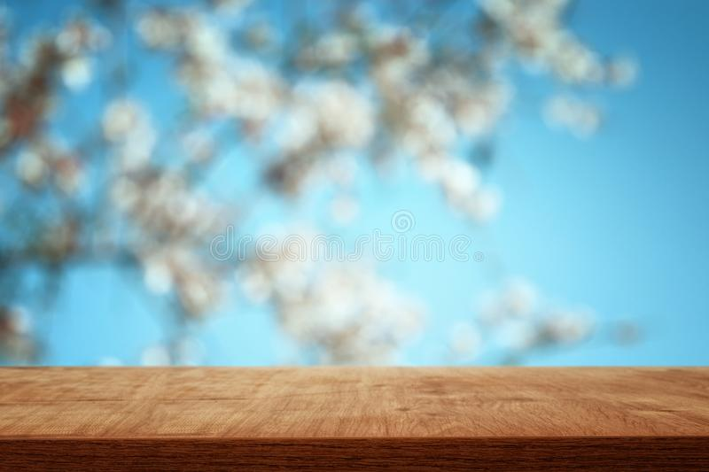 Wooden table in front of spring blossom tree landscape. Product display and presentation. Wooden table in front of spring blossom tree landscape. Product royalty free stock photos