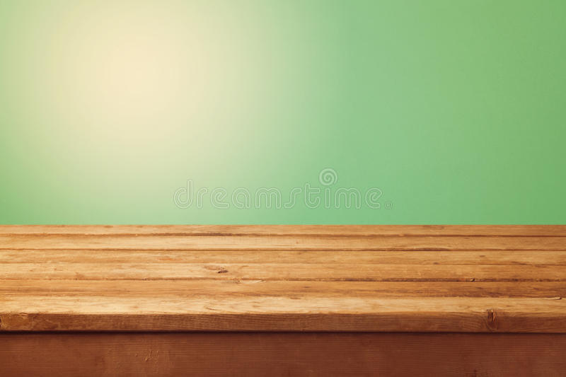 Wooden Table And Green Background For Product Montage