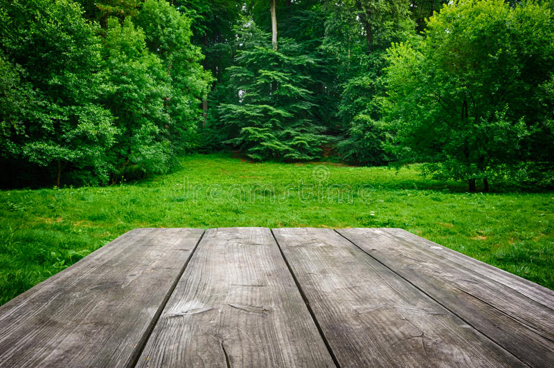 Wooden table with green nature background royalty free stock photography