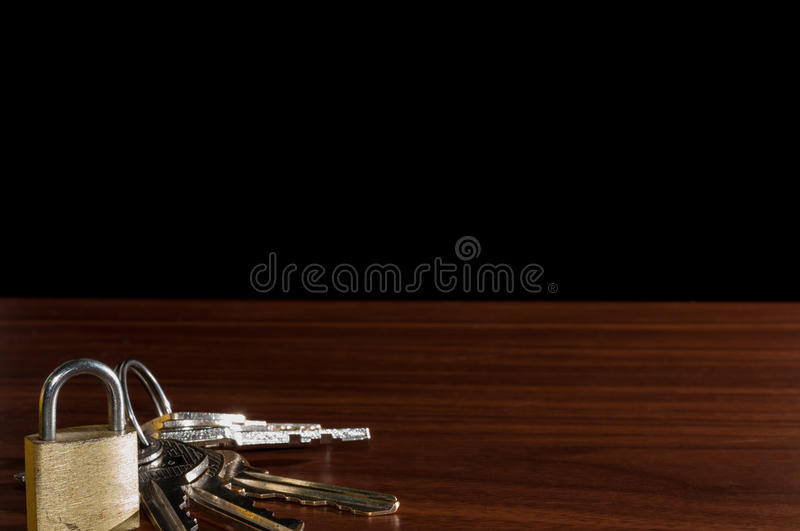 The wooden table,Keychain on the table background.  royalty free stock image