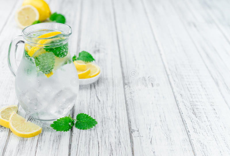 Wooden table with Lemonade selective focus. Lemonade with Balm as high detailed close-up shot on a vintage wooden table selective focus royalty free stock images