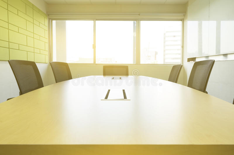 Wooden table in meeting room with sound absorber sunlight from window royalty free stock image