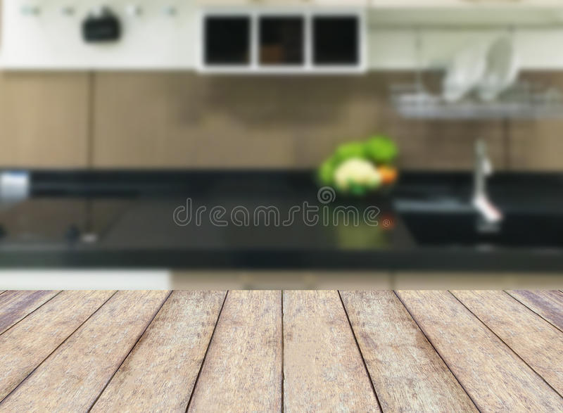 Wooden table on modern kitchen interior royalty free stock photo