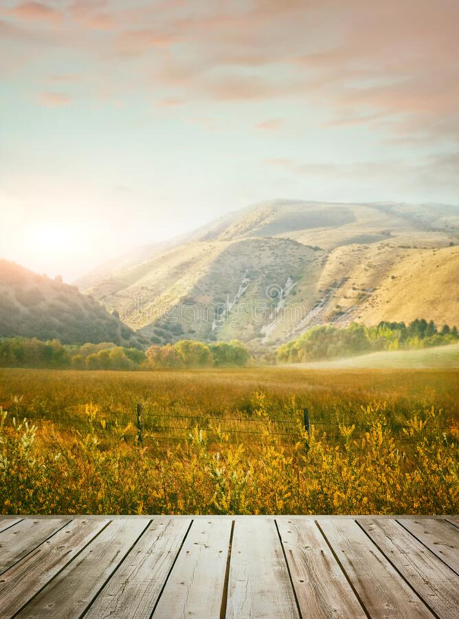 Wooden table with mountains in background royalty free stock image