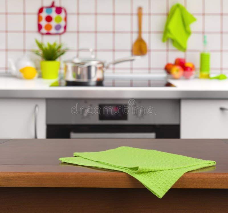 Kitchen Background Image: Wooden Table With Napkin On Kitchen Background Stock Photo