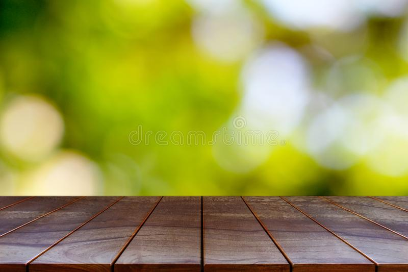 Wooden table on natural background for product display montage.  stock photos