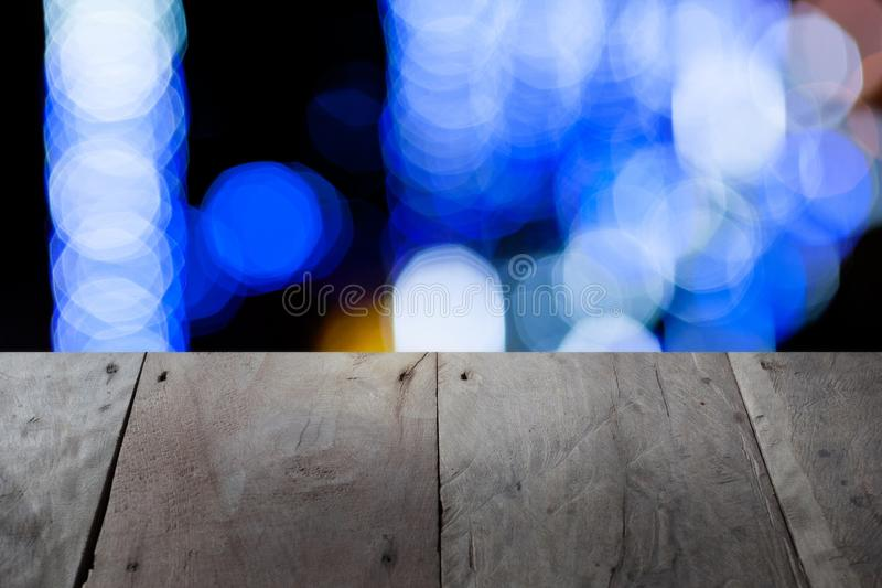 Wooden table over blurred background for show your product on image. Empty, display, montage, top, board, brown, light, toy, shop, store, place, design royalty free stock photo