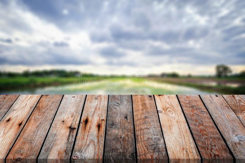 Wooden table over blurred background for show your product on image. Empty, display, montage, top, board, brown, light, toy, shop, store, place, design stock photos
