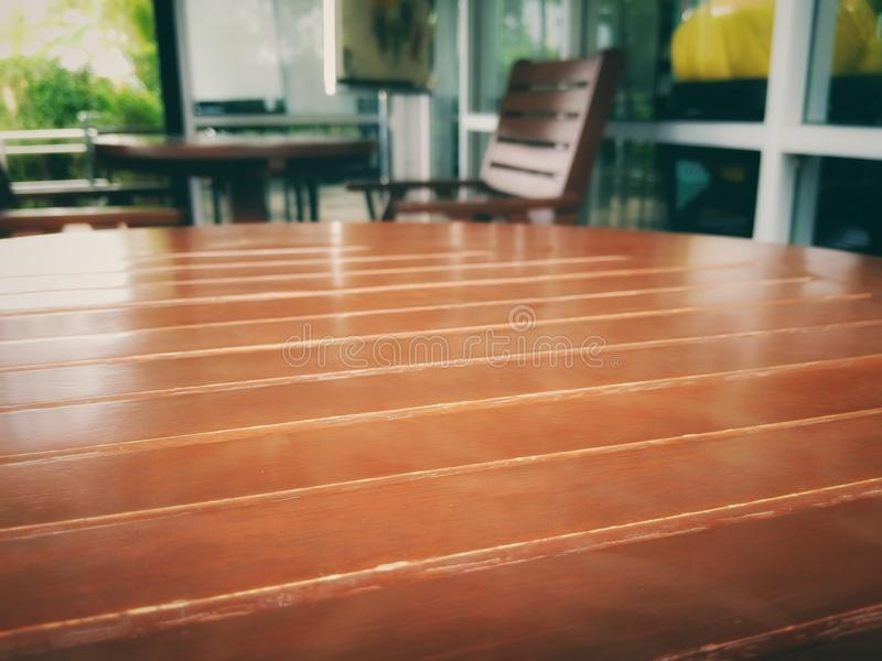 Wooden table. Set in front of the shop stock photos