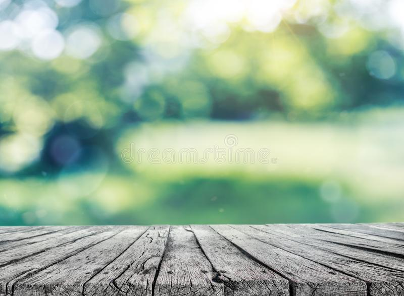 Wooden table and spring blurred background. A wooden table and field blurred background royalty free stock photo