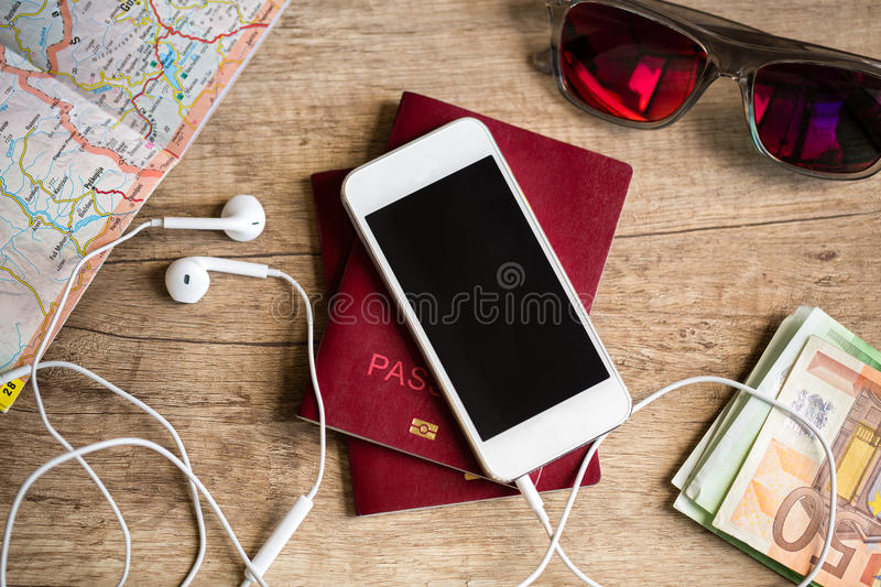 Wooden table with things for travel stock images