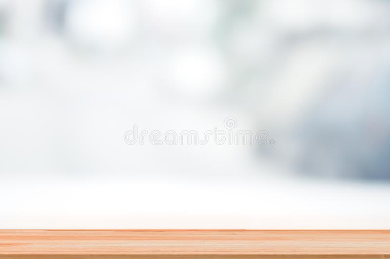 Wooden table top on abstract blur white background for backdrop design royalty free stock photography