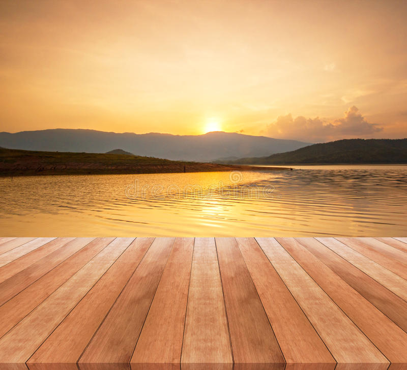 Wooden table top and beautiful landscape with sunrise stock photo