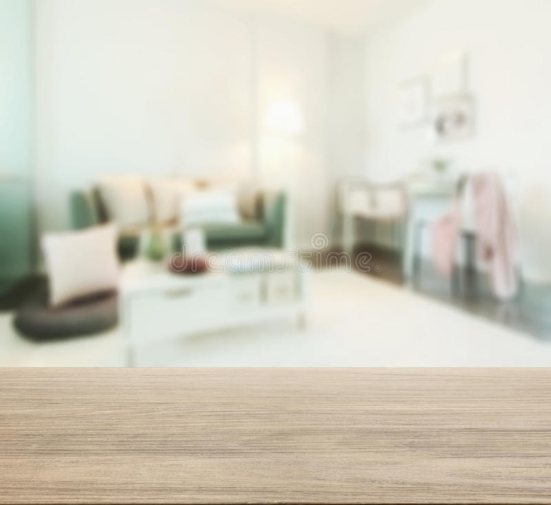 Wooden Table Top With Blur Of Living Room In Modern Interior Style ...