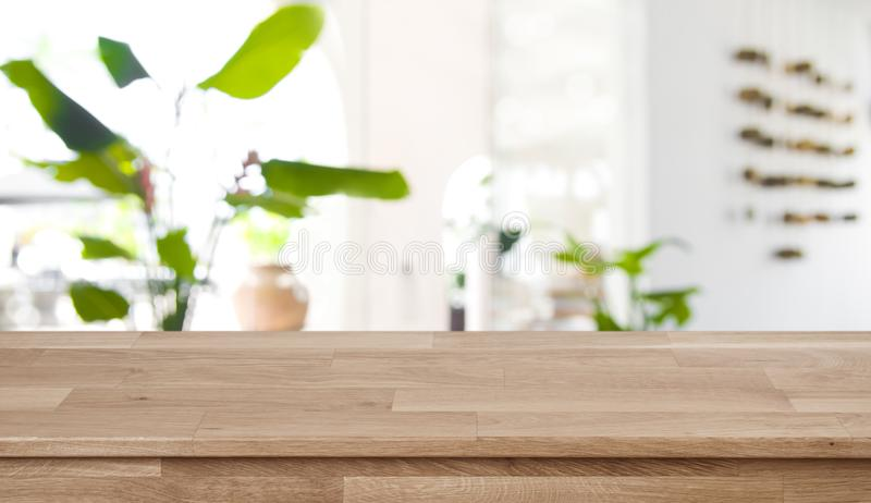 Wooden table top on blurred abstract interior of tropical resort stock photos