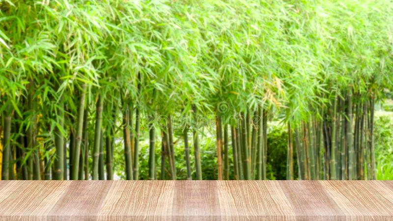 Wooden table top on green nature background royalty free stock photos