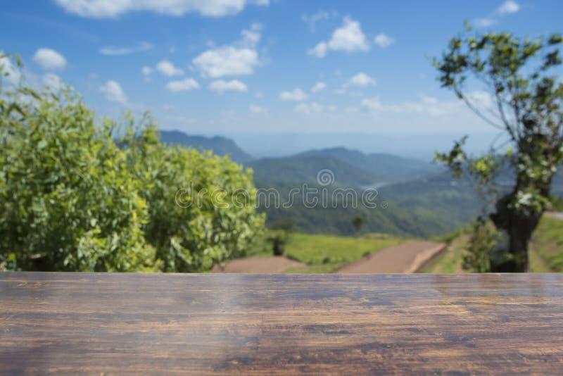 Wooden table top with mountain stock photos