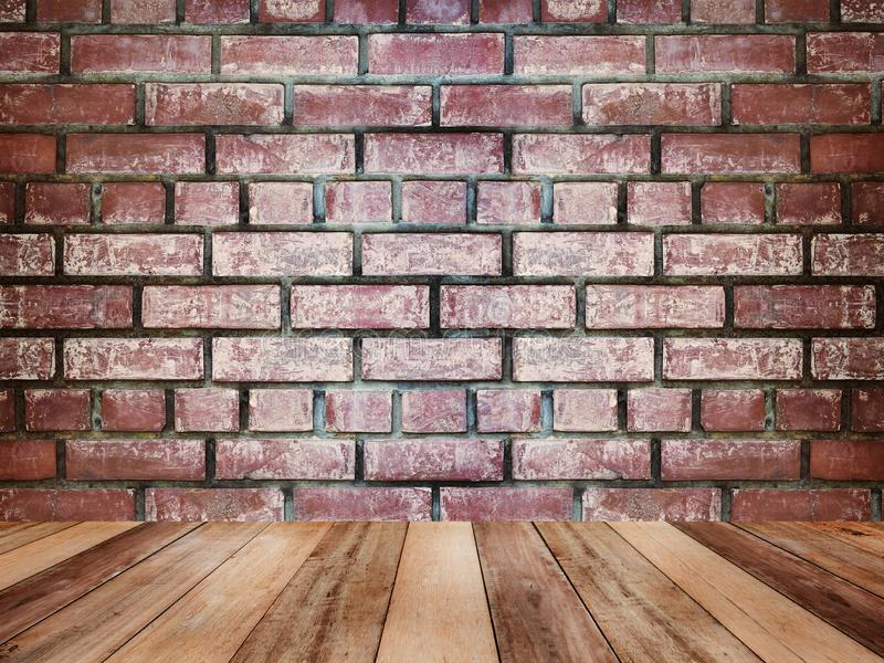 Wooden table top over vintage brick wall texture and background stock image