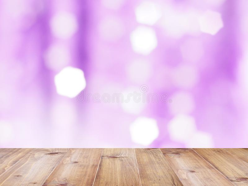 Wooden table top over violet abstract blured background royalty free stock image