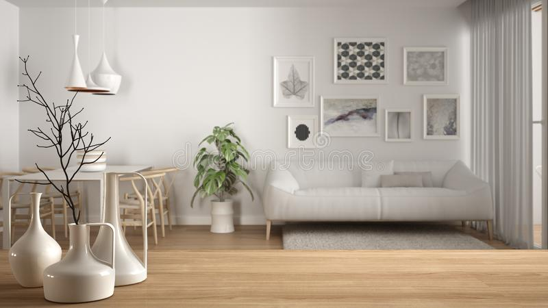 Wooden table top or shelf with minimalistic modern vases over blurred modern white living room with wooden details and parquet. Floor, minimalist architecture stock image