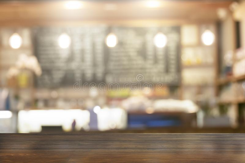 Wooden table top with view blurred beverages coffee bar backdrop stock images