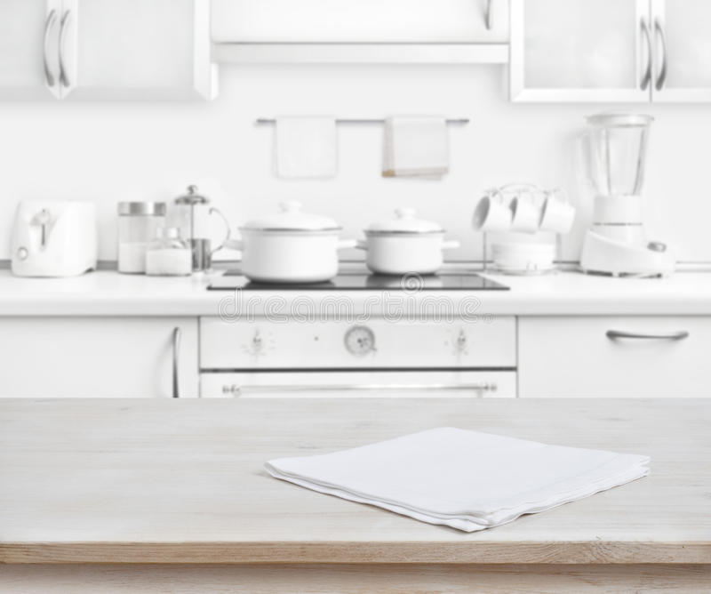 Download Wooden Table With Towel On Blurred White Modern Kitchen Background  Stock Photo   Image: