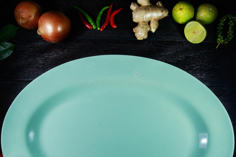 Wooden table with a vegetables. On border royalty free stock photography
