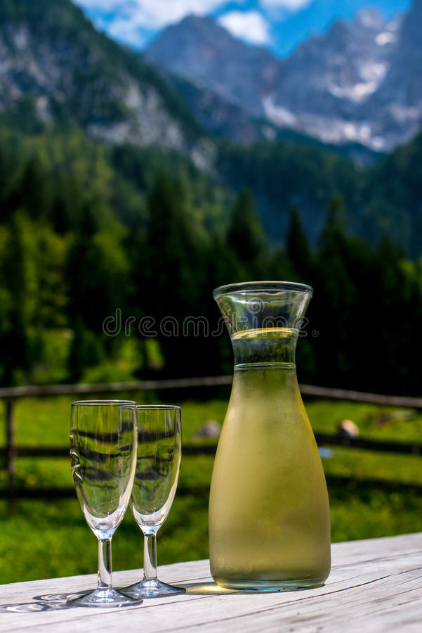 Wooden table with wine on the background of mountains.  royalty free stock photo