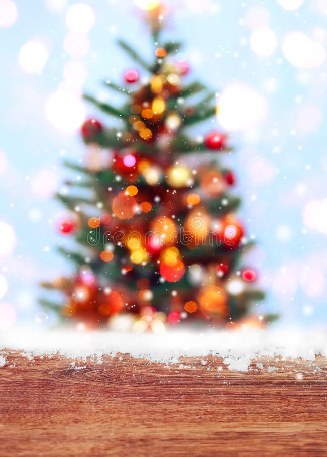 Free Wooden Table With Snow Place And Christmas Tree Background With Blurred, Sparking, Glowing. Royalty Free Stock Photo - 105711935