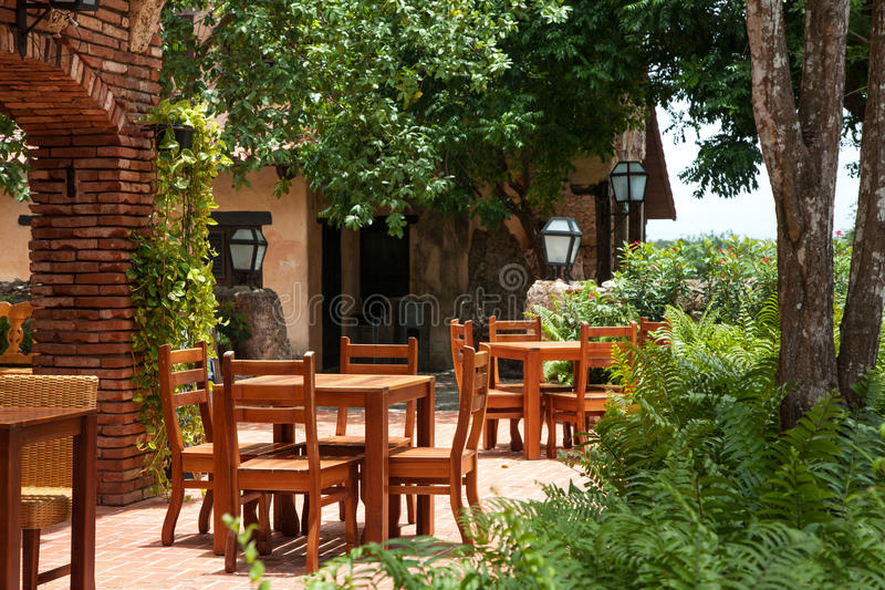 Wooden tables in a tropical restaurant stock photography