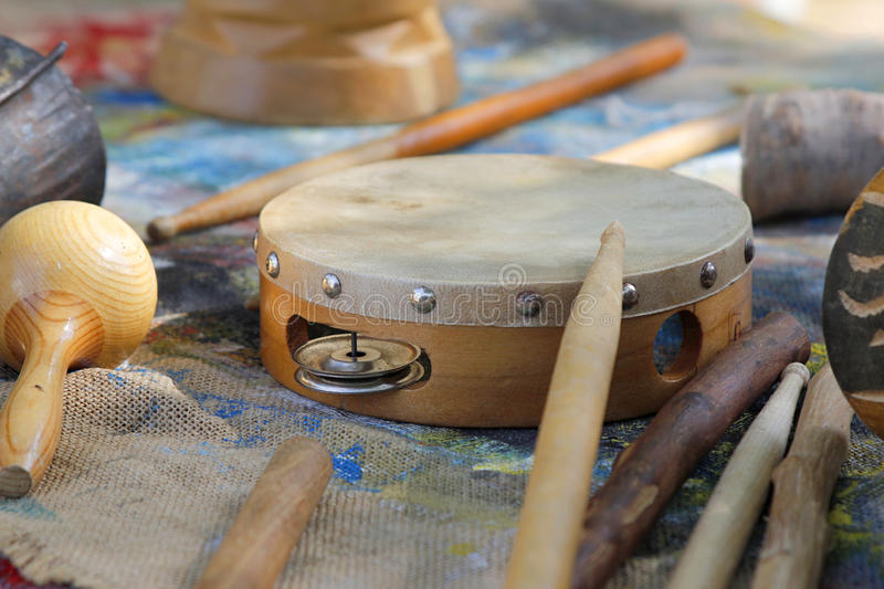 Wooden Tambourine. With other African instruments stock photos