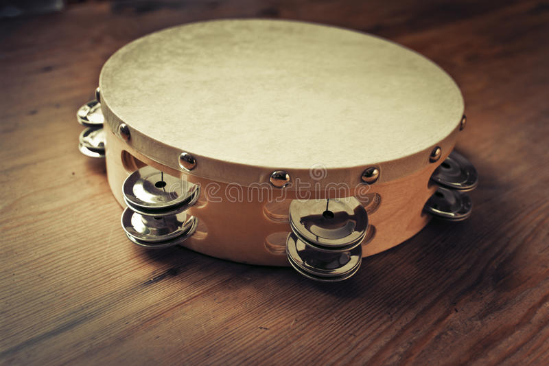 Wooden tambourine. On a table royalty free stock photography