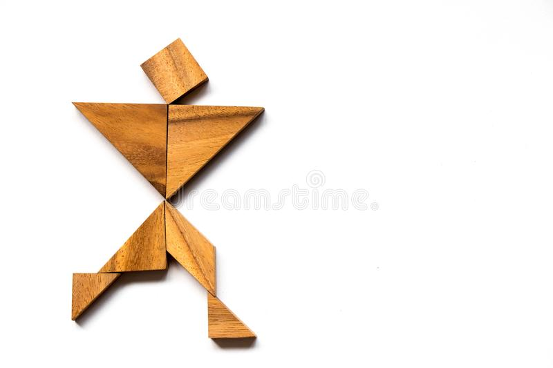 Wooden tangram as happy man shape on white background. Concept as business has success royalty free stock images