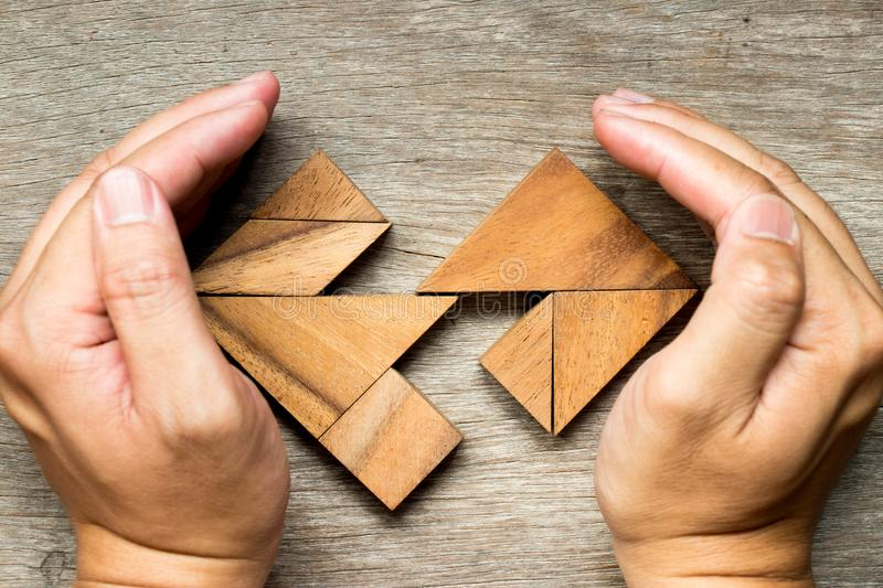 Wooden tangram puzzle in separate heart shape royalty free stock photos