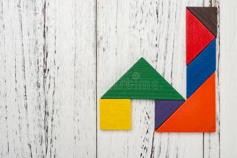 Wooden tangram shaped like a factory with tall funnel royalty free stock image