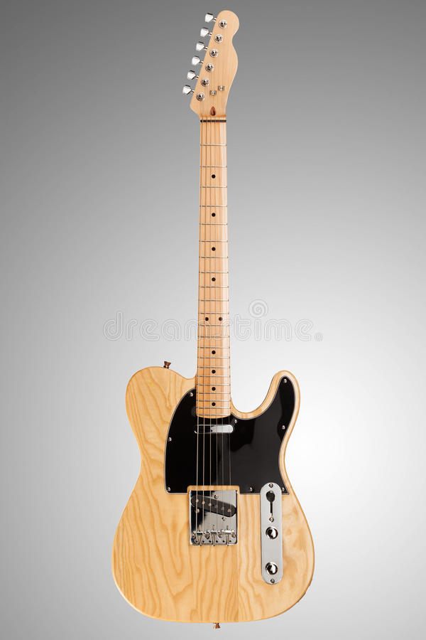 Wooden telecaster guitar. Wooden telecaster form six string guitar on neutral background stock image