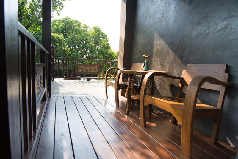 Wooden terrace and classic chair for background usage.  royalty free stock photos