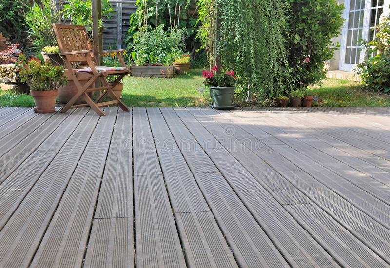Wooden terrace in garden royalty free stock photography
