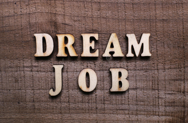 Wooden Text Dream Job. With rustic wooden background stock images