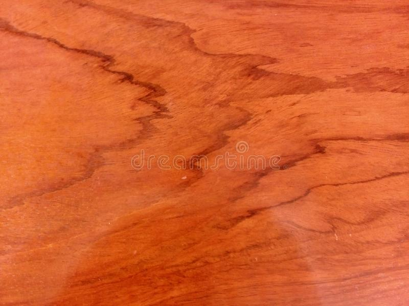 Red wooden texture with oil - some reflexes on the wood stock photography