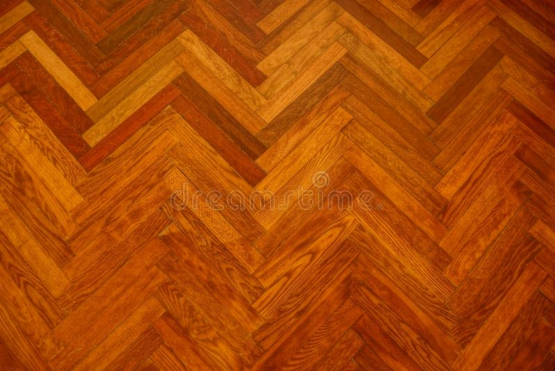 Wooden texture of old brown parquet boards royalty free stock photography