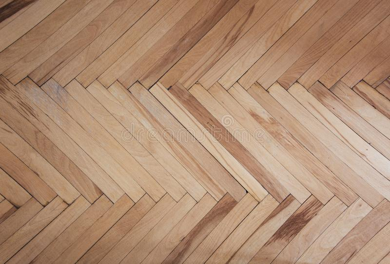 Wooden texture of parquet pattern brownish background. Herringbone. Wooden texture of parquet pattern brownish red background. Herringbone royalty free stock photo