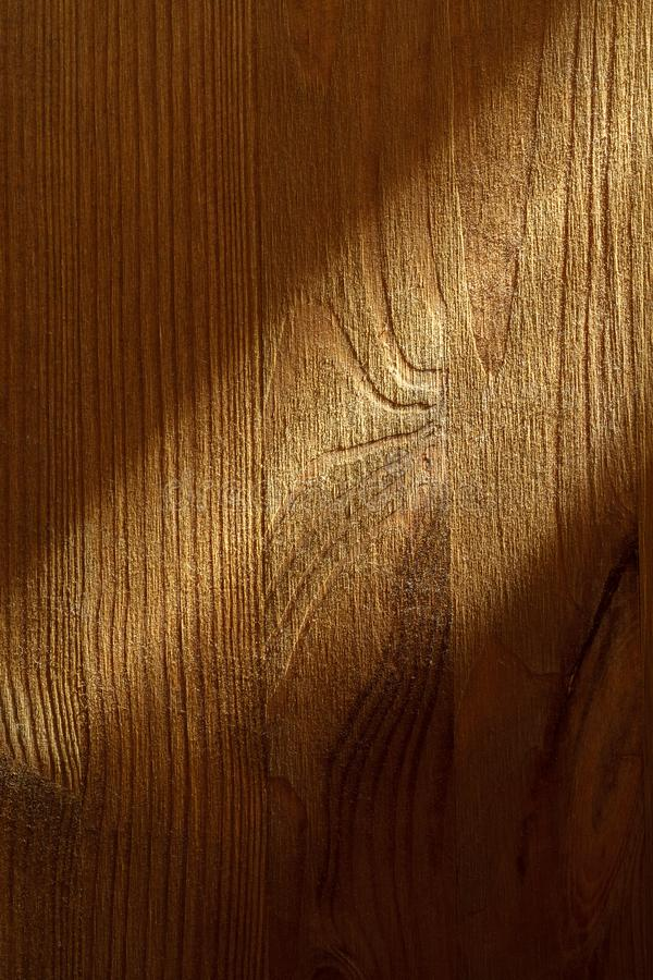 Wooden texture with sunbeam on it, closeup.  stock photos