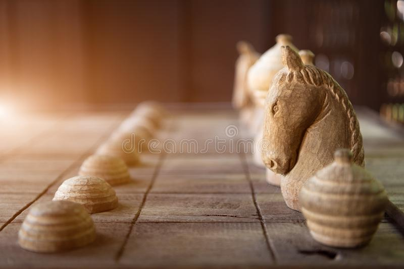Wooden Thai chess on wooden board. Strategy and hobby concept. Business and leisure theme stock image