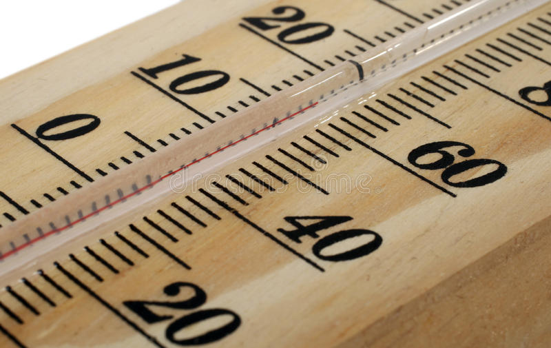 Wooden thermometer macro stock images