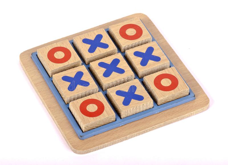 A wooden tic tac toe game. On an isolated background stock images