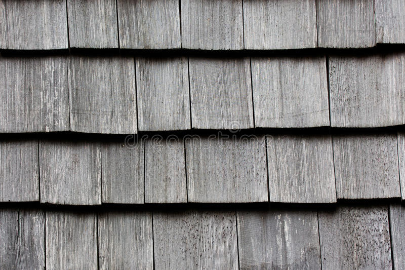 Wooden tile on the roof of a house. Wooden tile on the roof of the house royalty free stock images