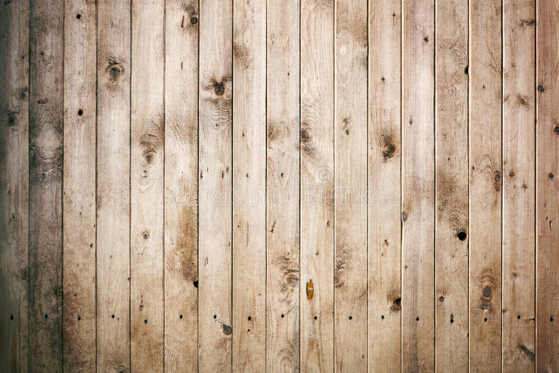 Wooden tiled wall made from pine planks. stock image