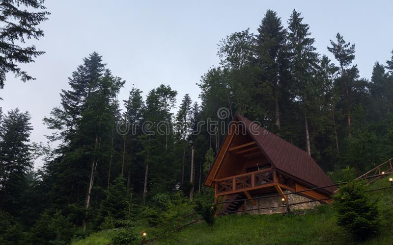 Wooden tiny house in the forest on top of the mountain royalty free stock image